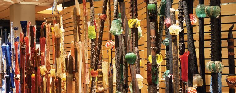 """The 30-foot-long art fence, """"Indigenous Evolution,"""" by Rosemary Lonewolf (Santa Clara Tewa) and Tony Jojola (Isleta) greets visitors at the entrance of the Heard's signature exhibition, """"HOME: Native People in the Southwest."""""""