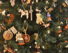 A tree displaying ornaments for sale during Ornament Marketplace