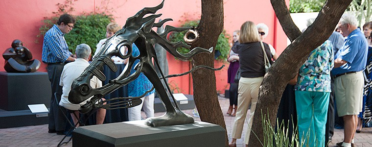 Members enjoy a function in the Nichols Sculpture Garden surrounded by beautiful sculpture
