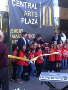 Phoenix Mayor Greg Stanton gets help from members of the Rose Lane Elementary School choir in cutting a ribbon dedicating the Central Arts Plaza at 1850 N. Central Ave., Phoenix, on March 4. The plaza and Central Arts Tower are designated by the city as centerpieces of the Central Arts District, a consortium of arts venues including the Heard Museum.