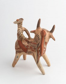 Photograph of bull with rider figurine. Unknown artist (Ameyaltepec, Guerrero, Mexico). Bull with rider figurine, 1979. Ceramic, paint. Purchased with funds provided by the Friends of Mexican Art (FOMA).