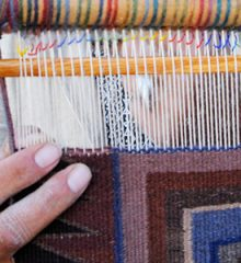 2012 Indian Fair and Market. Detail of Navajo weaver Brenda Spencer weaving. Photo by Jewel Clark