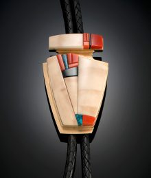 Richard Chavez (San Felipe Pueblo) Bolo tie of fossilized ivory, coral, black jade, turquoise and 14K gold, 1998.