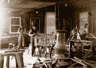 1890 black and white photo of young Native men in a woodworking shop