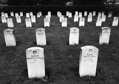 Black and white photograph of turn of the century graves at the Carlisle Indian School cemetery.