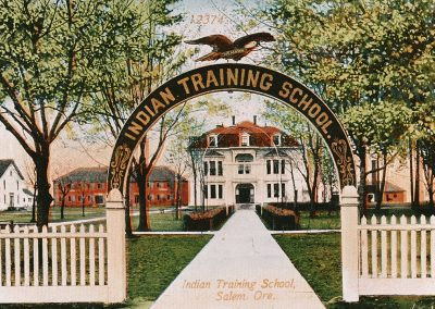 Colorzied photo of the entrance to the Chemewa Indian Training School in Salem, OR around 1900.