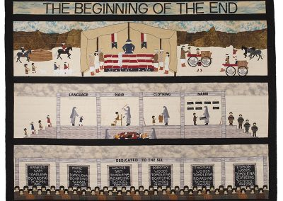 "artwork pieced quilt with the words ""The beginning of the end"" at the top. 3 panels show Native people signing treaties, scenes of boarding school and the names of 6 students known to the artist who attended Toadlena Boarding School"