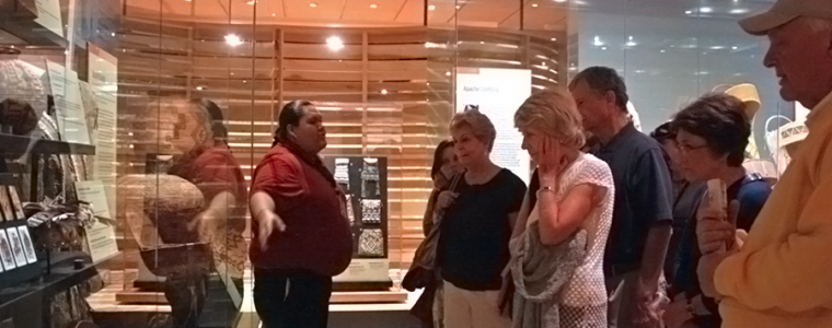 Adult group being guided through the HOME exhibit.