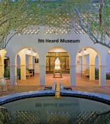 """Entrance to the Heard Museum, featuring the sculpture """"Earth Song"""" by Allan Houser (Chiricahua Apache)."""