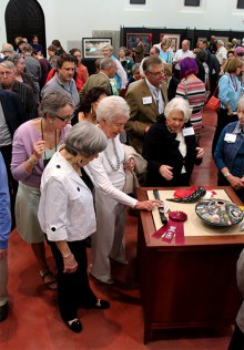 Photograph of guests admiring Juried Competition submissions