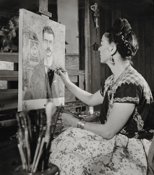 Frida painting the portrait of her father by Gisèle Fruend, 1951. Copyright Frida Kahlo Museum.