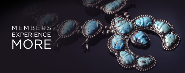Members Experience More text over photo of a traditional Navajo squash blossom necklace in silver and large turquoise cabochons.