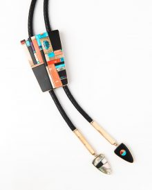Sonwai — Verma Nequatewa (Hopi, b. 1949) Bolo tie, 2016 Coral, turquoise, lapis lazuli, sugilite, wood, fossilized ivory, abalone, 18k gold Collection of Quincalee Brown and James P. Simsarian