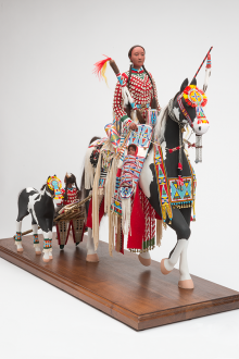 Rhonda Holy Bear. Cheyenne River Sioux and Lakota, b. 1959. Maternal Journey, 2010. Wood, gesso, paint, clay, cotton, wool, metal, glass micro-beads, brain-tanned buckskin, rawhide, fur, hair, feathers. 31 x 42 inches. Collection of Charles and Valerie Diker. Photograph by Craig Smith