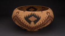 CARRIE BETHEL (MONO LAKE PAIUTE) 1898-1974Basket, 1956Sedge root, dyed bracken root, redbud, willow13 x 25 inchesCollection of Stevia and Wayne ThompsonImage courtesy of Craig Smith for Heard Museum