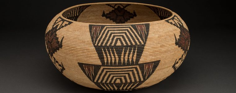 TINA CHARLIE (MONO LAKE PAIUTE) 1869-1962Basket, 1928Sedge root, dyed bracken root, redbud, willow10 x 20 inchesCollection of Stevia and Wayne ThompsonImage courtesy of Craig Smith for Heard Museum