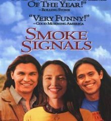 Cover of the film Smoke Signals with 2 Native young men and 1 Native young woman in front of a desert landscape.