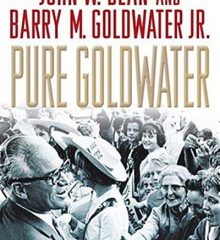 "Book cover of ""Pure Goldwater"" showing a black and white group photo of Barry Goldwater greeting crowds circa mid-20th C."