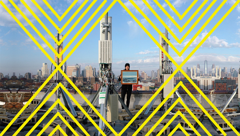Photo of cityscape in distance with woman holding a photo on the roof of a building. Yellow zigzagging geometric lines are overlayed on the photo.