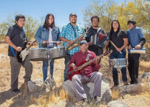 Joaquin Family of 7 people who make up the group Southern Scratch pose with instruments