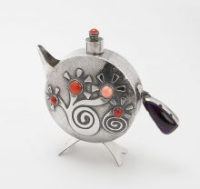 Canteen style teapot in silver with stylized floral design overlay set with coral and sugilite by Darrell Jumbo