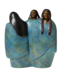 bronze sculpture by Doug Hyde showing 3 female figures swathed in large wraps in mottled turquoise colored patina. The women's faces and hair of difering styles are a smooth dark brown