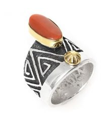 silver ring with triangular geometric designs set with oval coral cabochon in gold