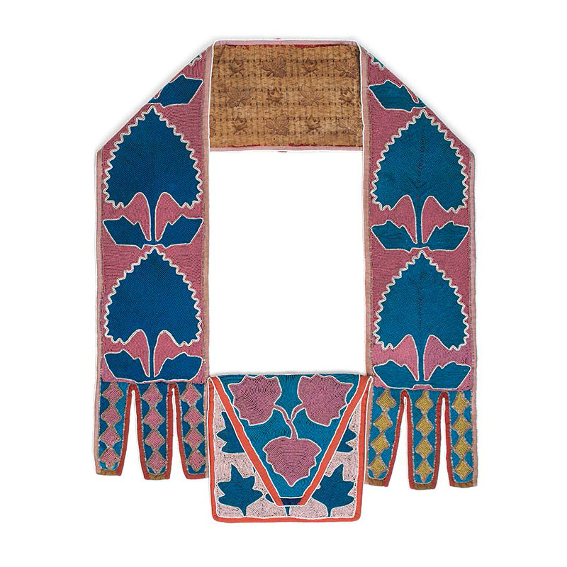 Bandoliere bag from the Delaware tribe, circa 1850s, with pink and blue beads over hide showing simple flower shapes