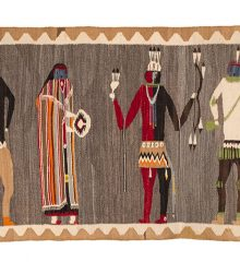 Navajo rug showing four Ye'iibicheii figures against a heathered brown background surrounded by a tan and cream zigzagging border