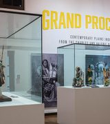 Grand Procession exhibition showing handmade and intricately beaded soft sculpture figures in traditional American Indian regalia/dress