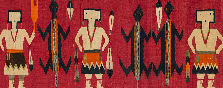 Navajo rug detail showing Yei figures with lizard figures on a bright red background