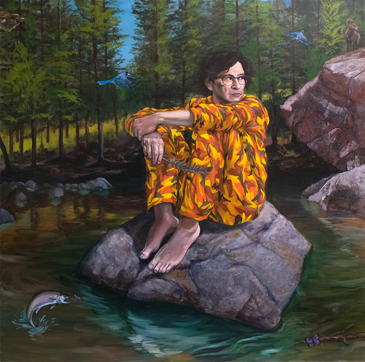 diptych by Steven Yazzie showing self portrait in orange camo style pajamas sitting on a rock in nature looking towards the other painting showing a coyote sitting on a cushioned arm chair in a studio/interior setting